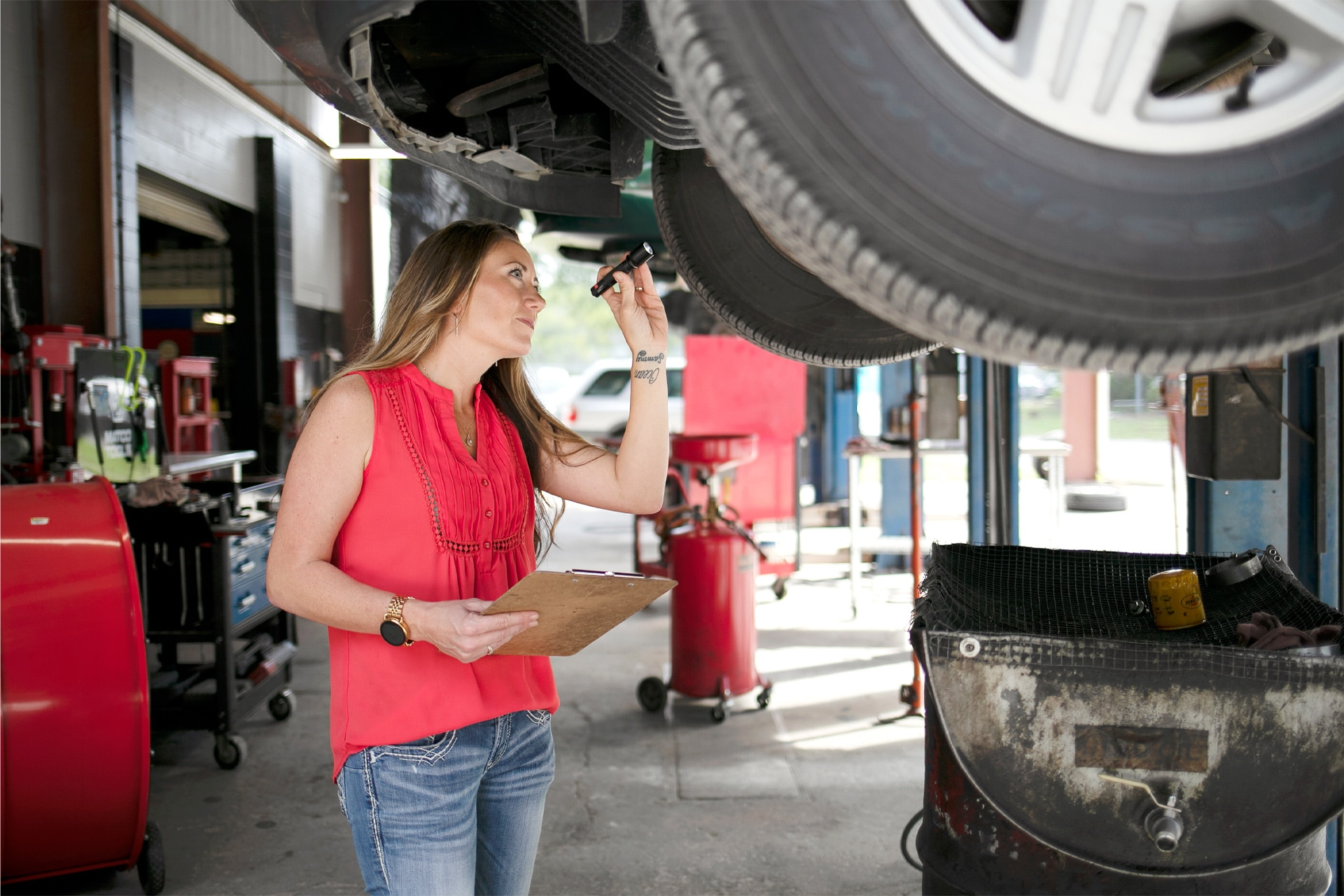 Rachael Wacha at City Auto Repair inspecting a car